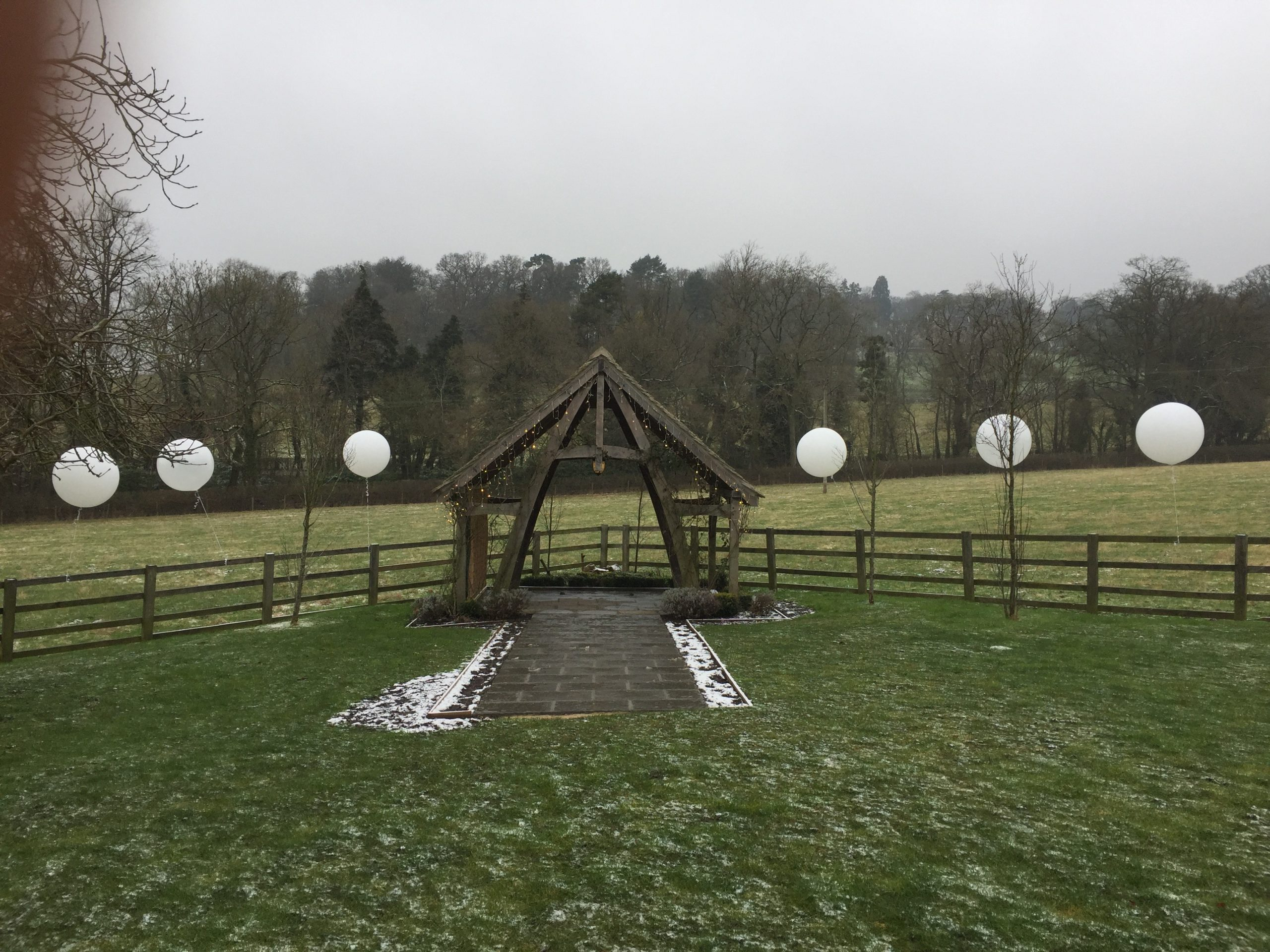 3ft Balloons along a fence