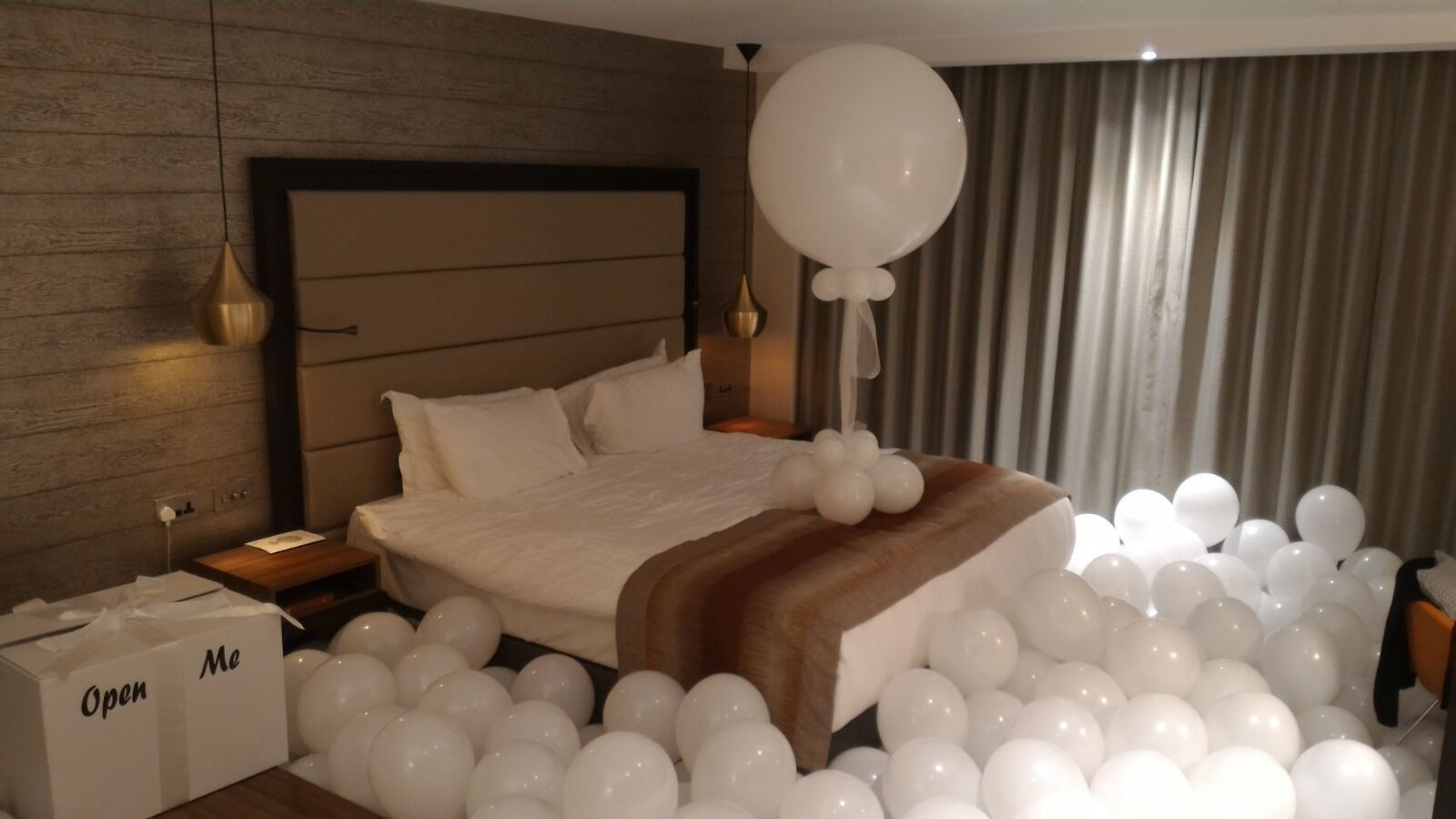 Hotel Room full Of Balloons for proposal