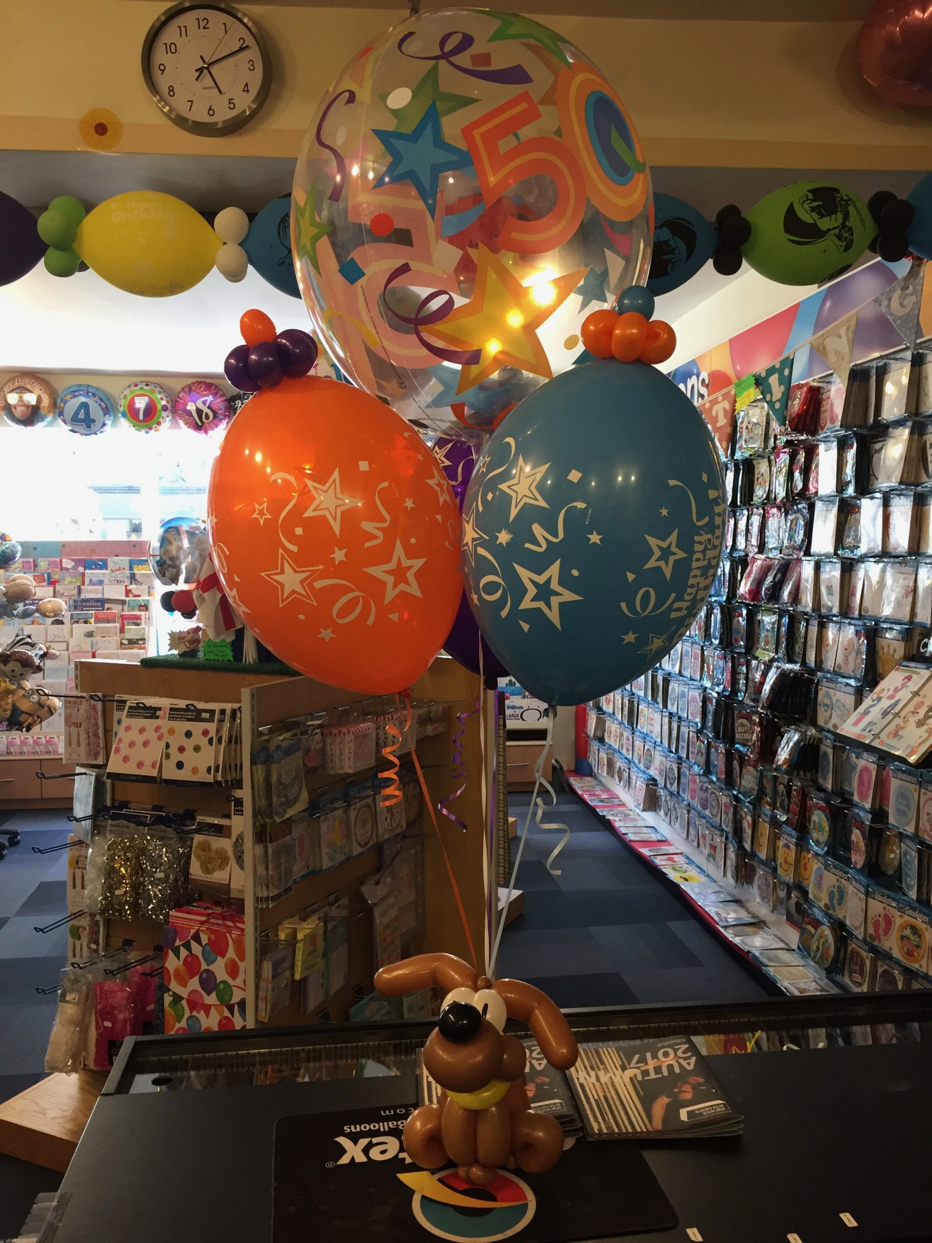 50th birthday balloons with balloon dog base