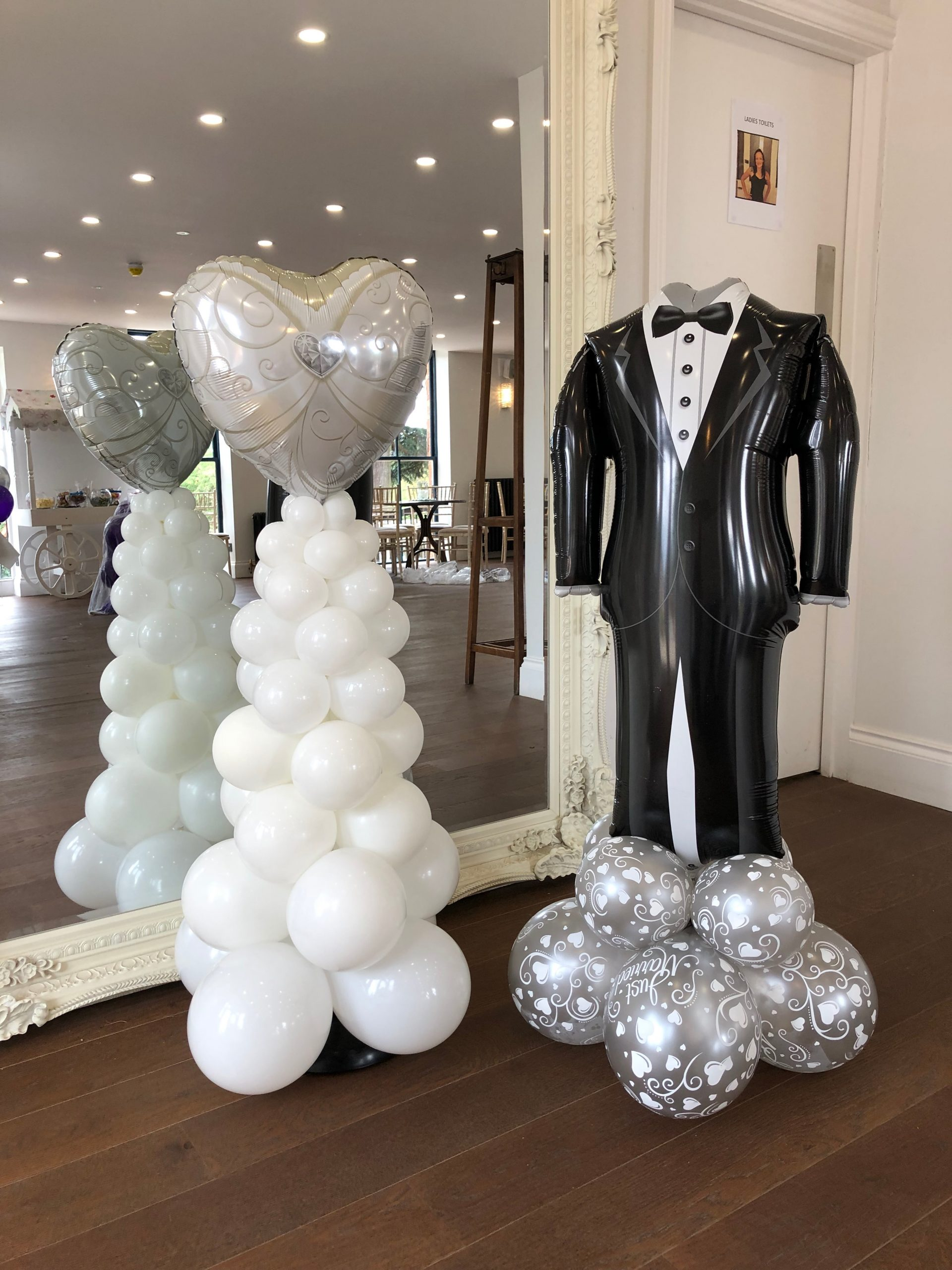 Bride and groom balloon columns