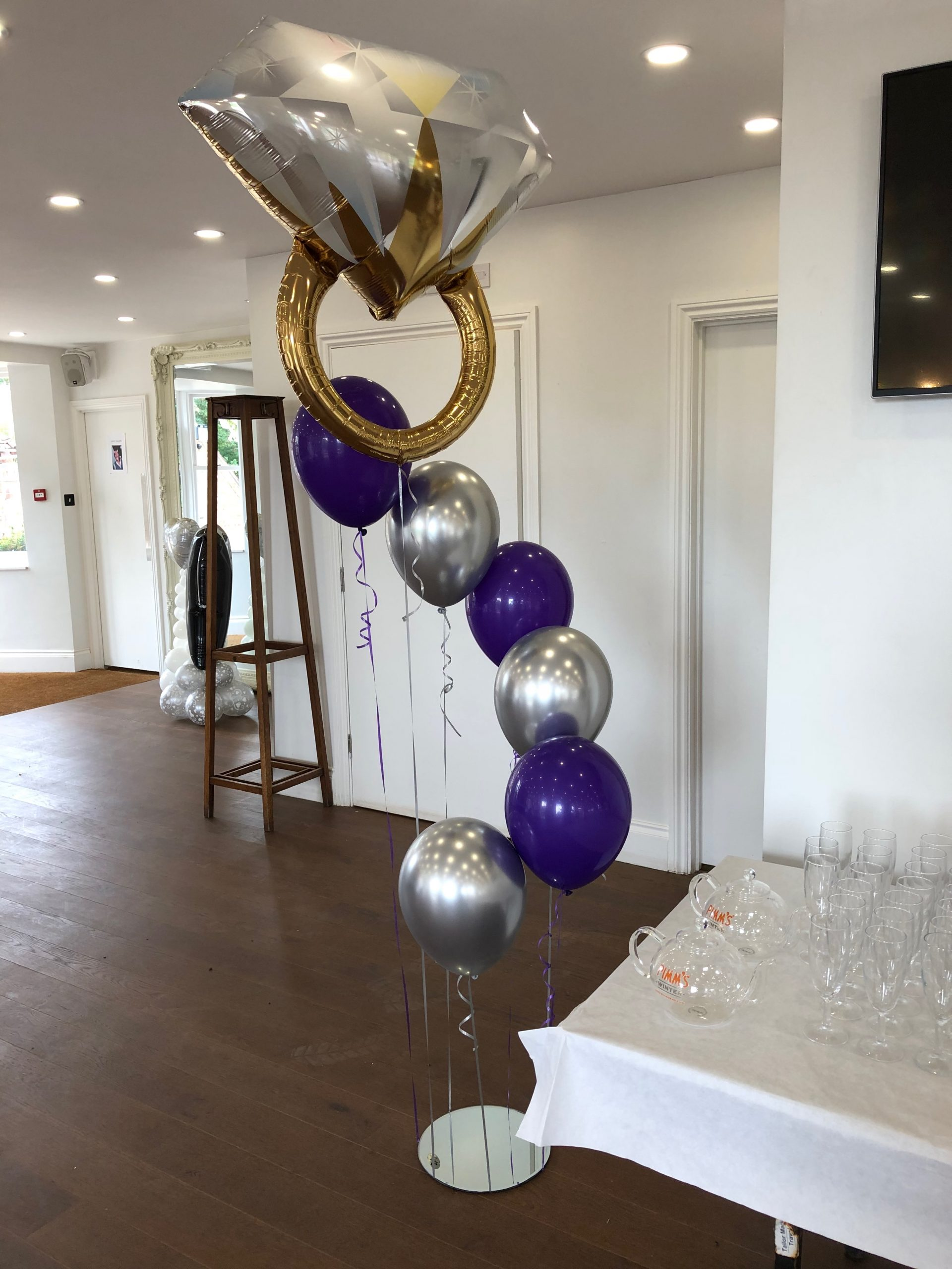 Spiral of floating wedding balloons with ring