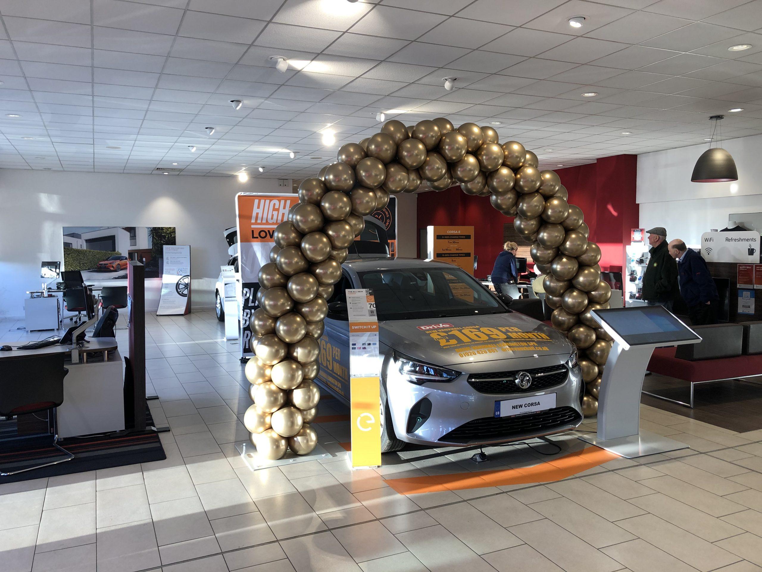 Golden spiral arch over new car.