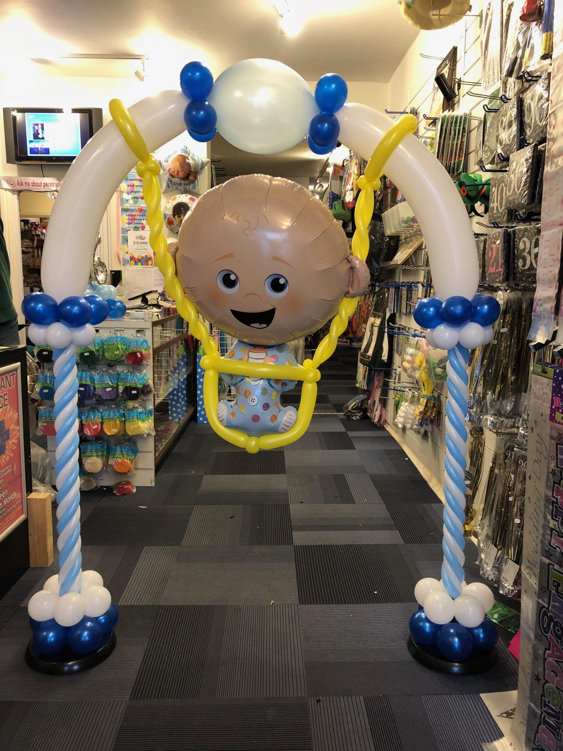 Balloon baby in swing