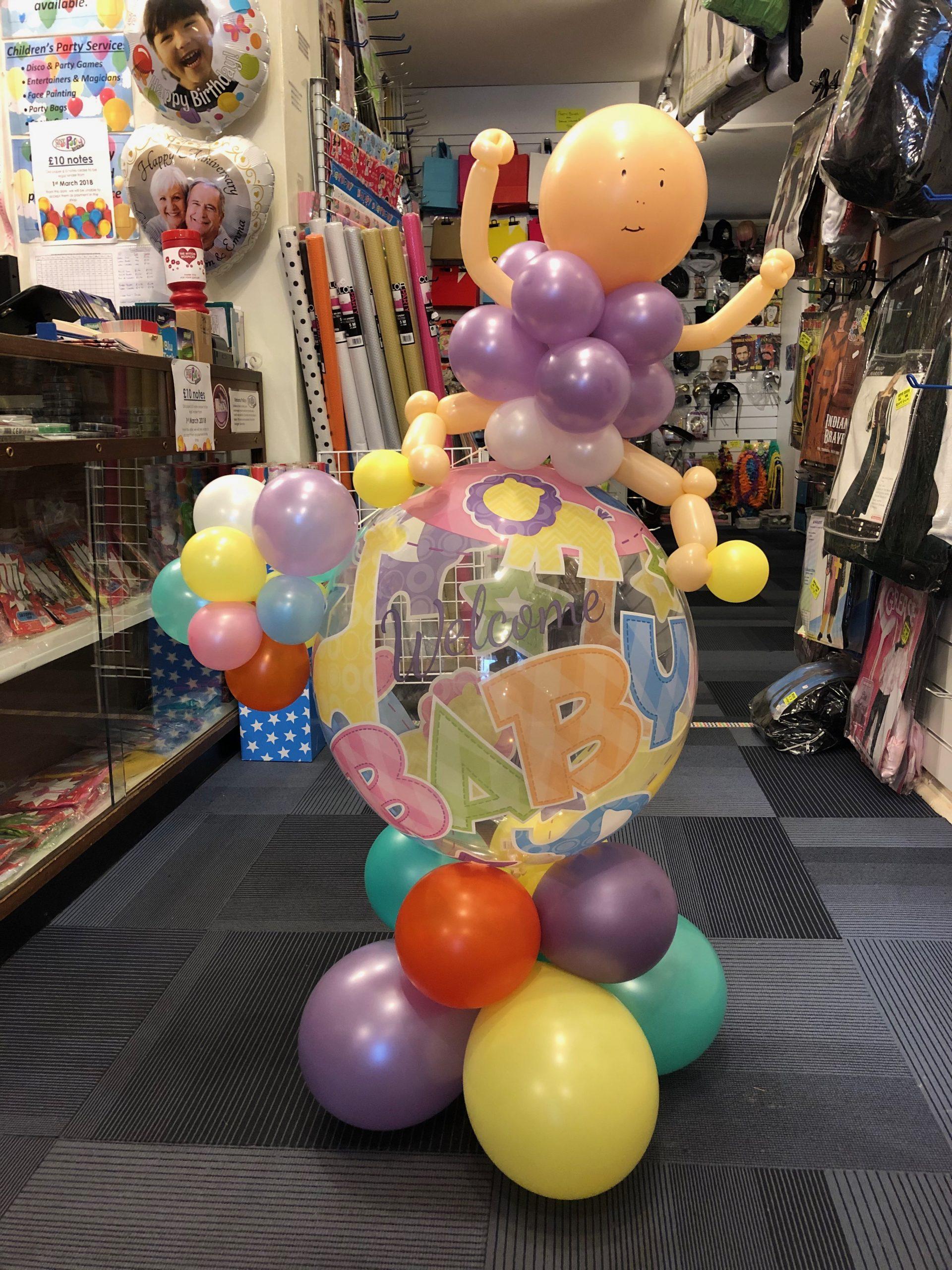 Balloon baby sitting on decoration