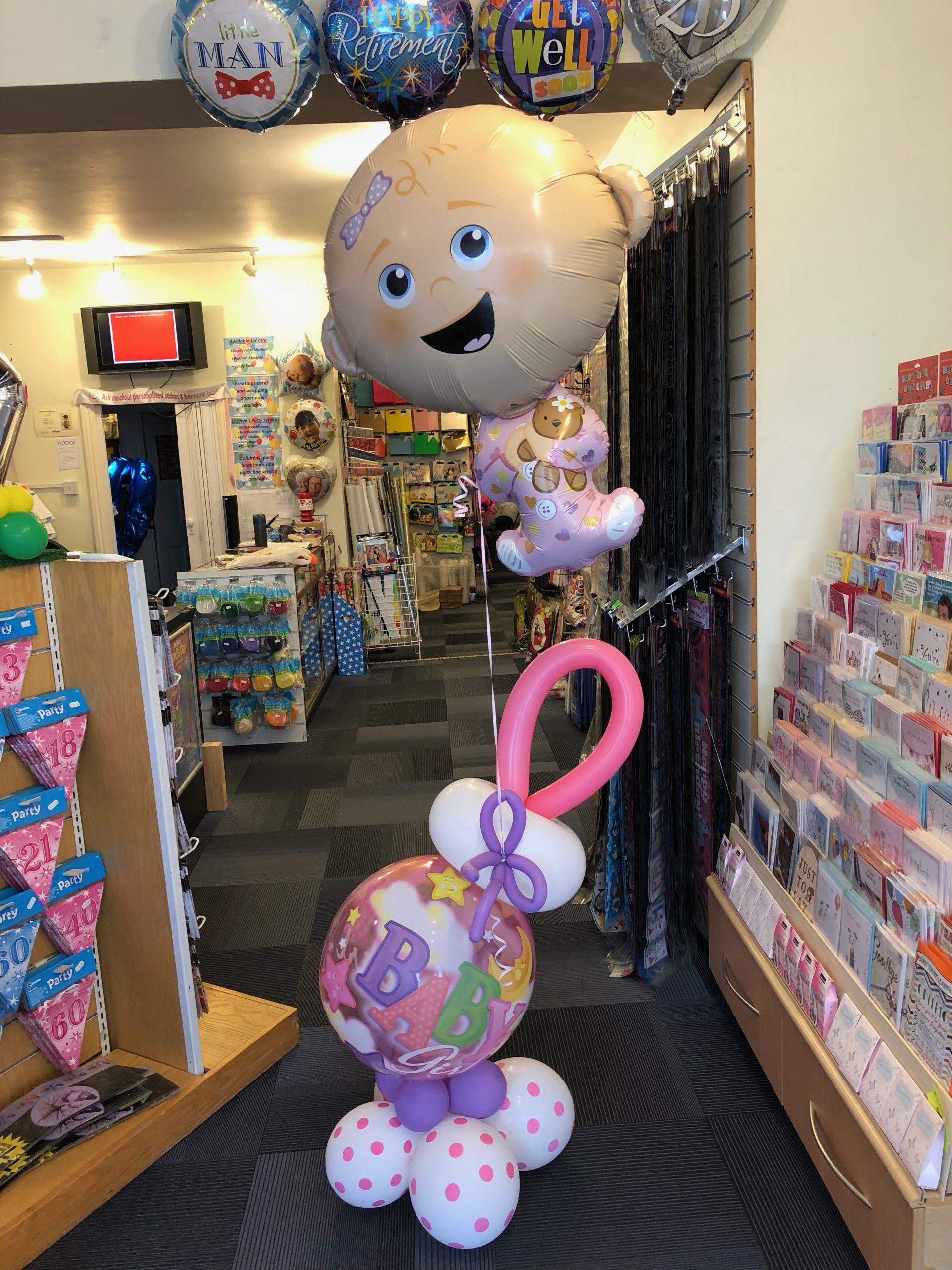 Balloon baby girl and balloon rattle